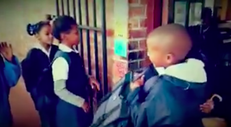 School pupils greet each other with a hug, fist pump and wiggle in Worcester