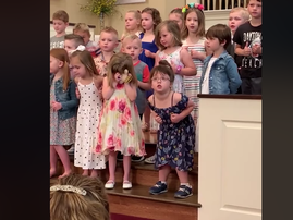 little girl busts dance moves at church