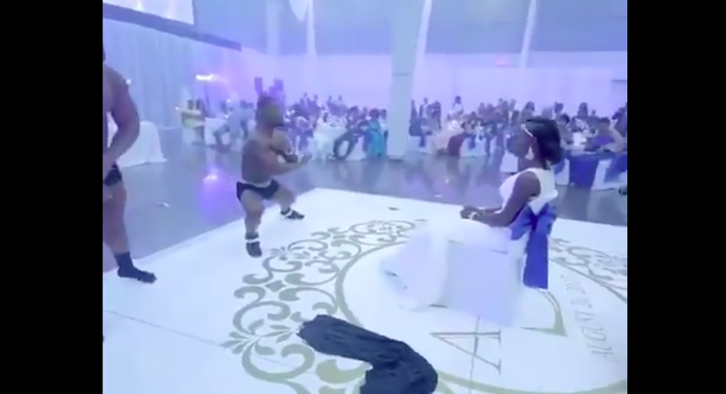 Man strips for his wife at their wedding