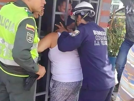 Woman spied on her neighbours and got her head stuck in the gate