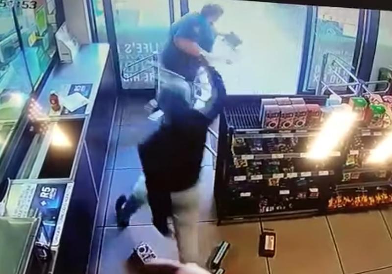 woman robbed of gun at a garage