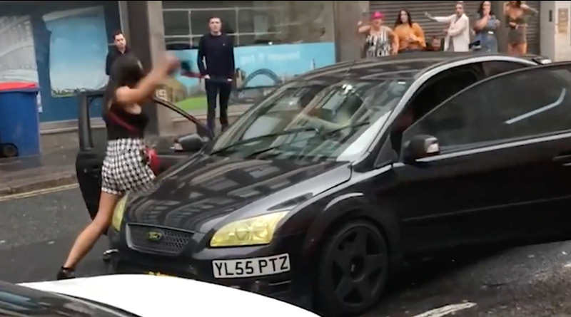 Woman hits car in road rage video
