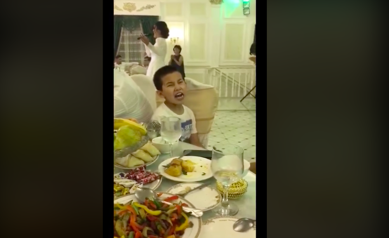 Kid mimics opera at wedding