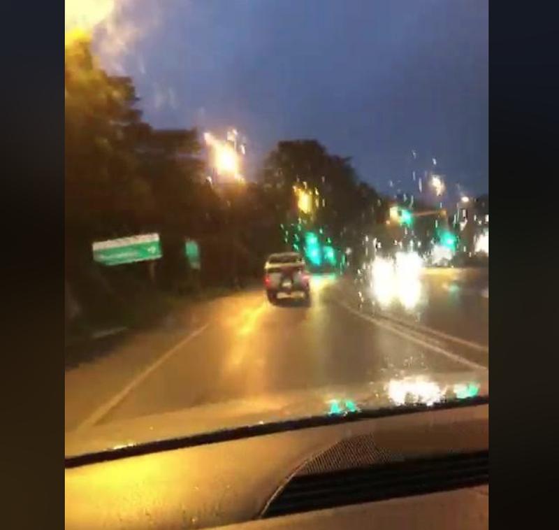 stranger climbs into woman's car