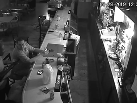 Man smokes cigarette during robbery