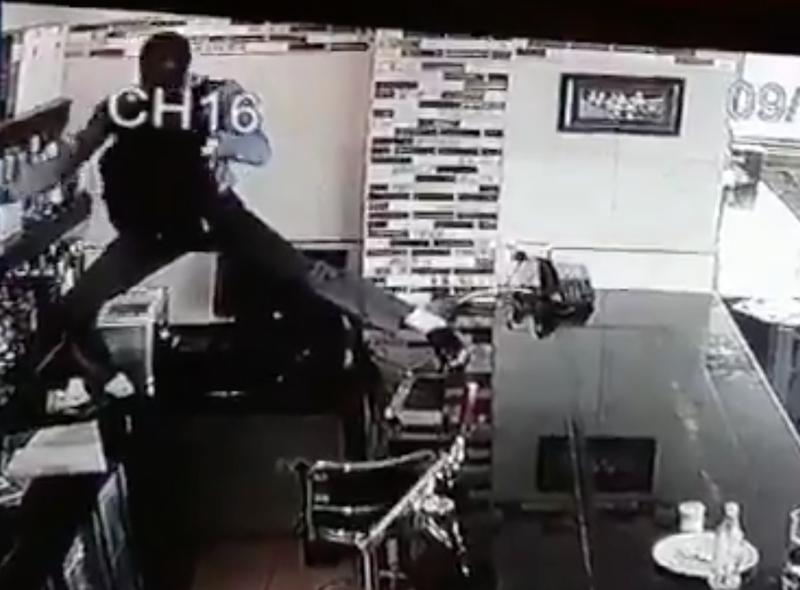 Man climbs over bar to steal booze
