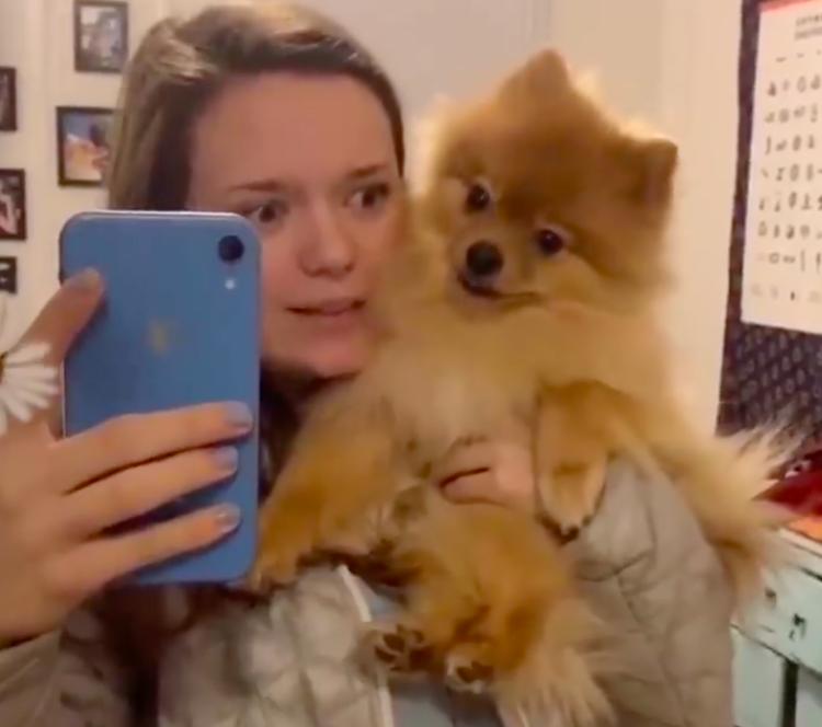 Girl Talking To Dog