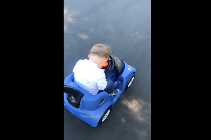 Baby falls asleep behind wheel