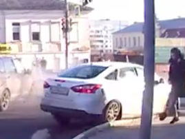 Horrific moment when two cars collide and almost hits pedestrian