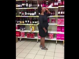 Woman Drinks In Store