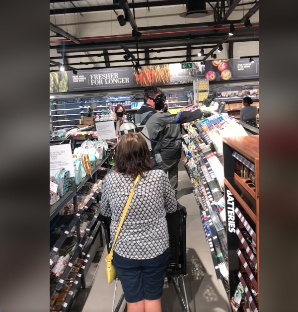 Man in diving suit shopping at Woolworths