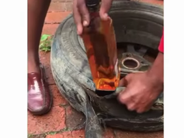 Men hide alcohol in spare tyre