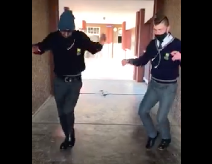 School friends showing off dance moves