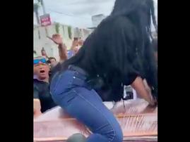 Woman twerks on coffin