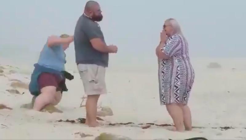 Local photographer falls while trying to capture beach proposal