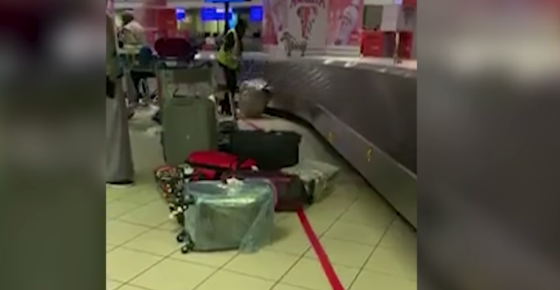 OR Tambo Airport employee caught on camera throwing luggage