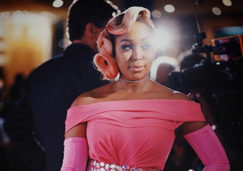 Minnie Dlamini in a pink dress / Instagram