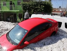 Hailstorm covers Mexican city in slush