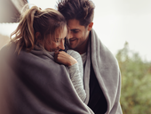 Romantic couple on a winter holiday / iStock