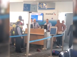 Irate man rips off his shirt in airport rampage