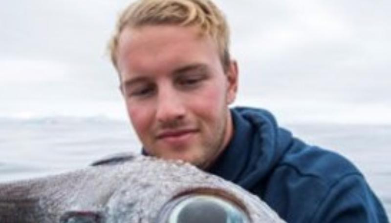 Fisherman catches weird 'dinosaur-like' creature with huge eyes