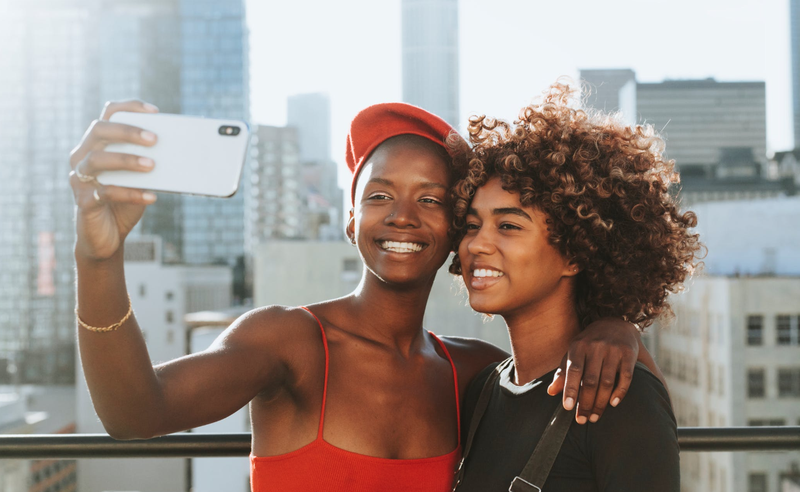 Two Women Taking Photo / Pexels