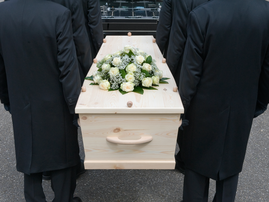 Bearers with coffin  / iStock