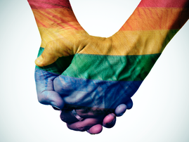 Gay couple holding hands / iStock