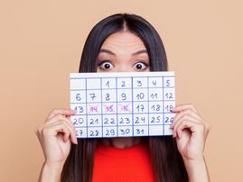 Woman with countdown calendar / iStock