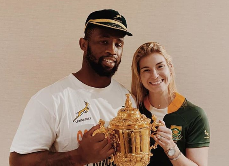 Rachel and Siya Kolisi holding the Webb Ellis Cup / Instagram