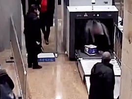 Man leaps into train station's security scanner