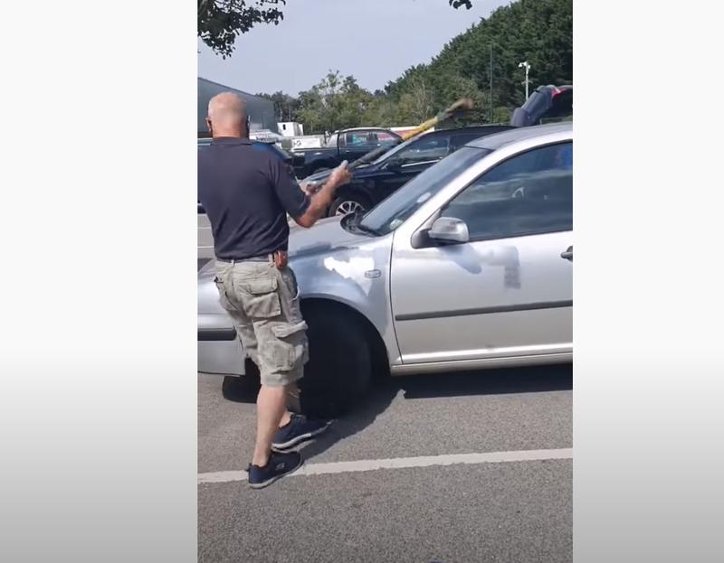 Man smashes car window