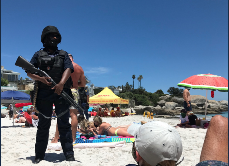 Cop with shotgun at Clifton beach