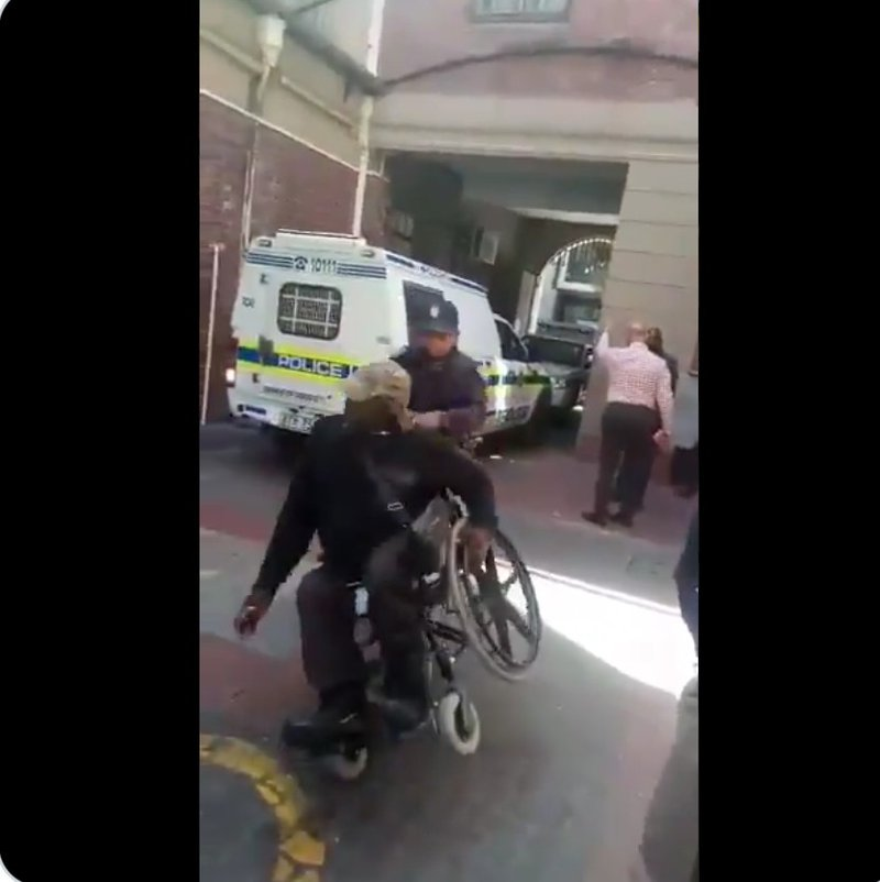 Cops throw disabled man off wheelchair