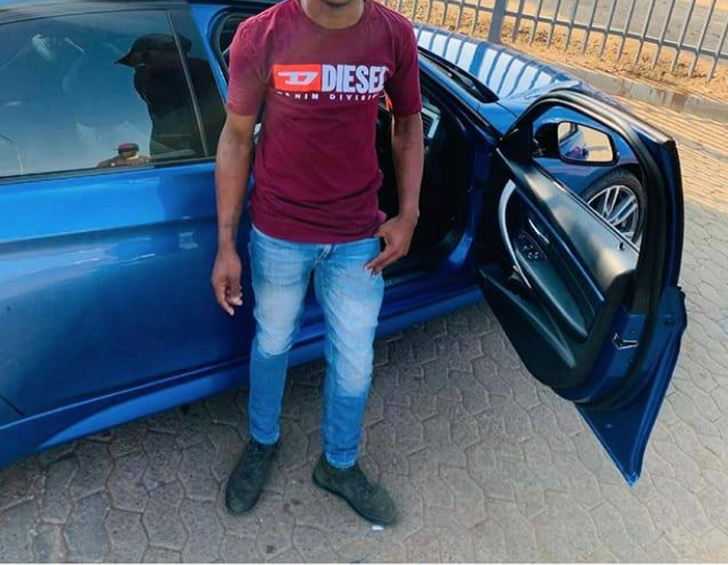 man poses with alleged stolen car