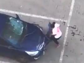 woman destroying car