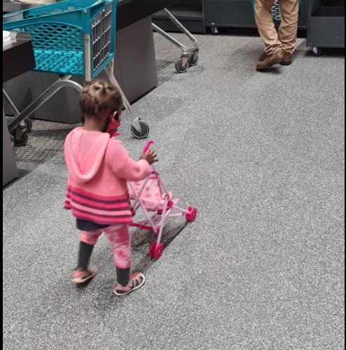 Child pushing toy stroller