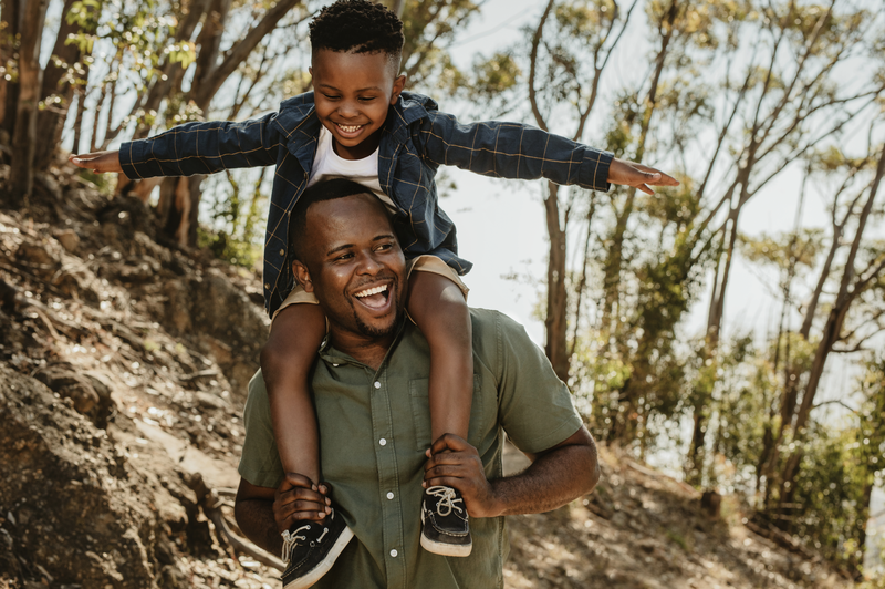 Father and son having a great time on vacation stock photo