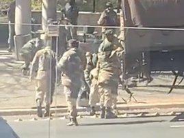 SANDF member struggling to get in military truck