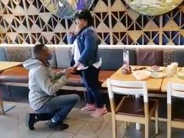 Couple getting engaged at Nandos