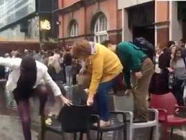 WATCH: Spotted in London, people using chair to get across flooded street