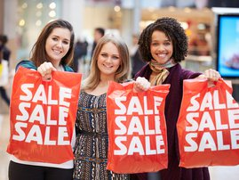 Women with sale shopping bags