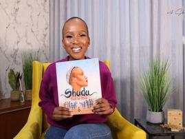 Shudufhadzo Musida holding her book