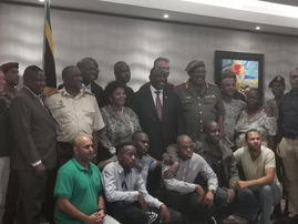 Ramaphosa with repatrication team
