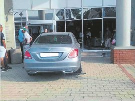 WATCH: Standard Bank customer ploughs her car through the building after teller failed to help her