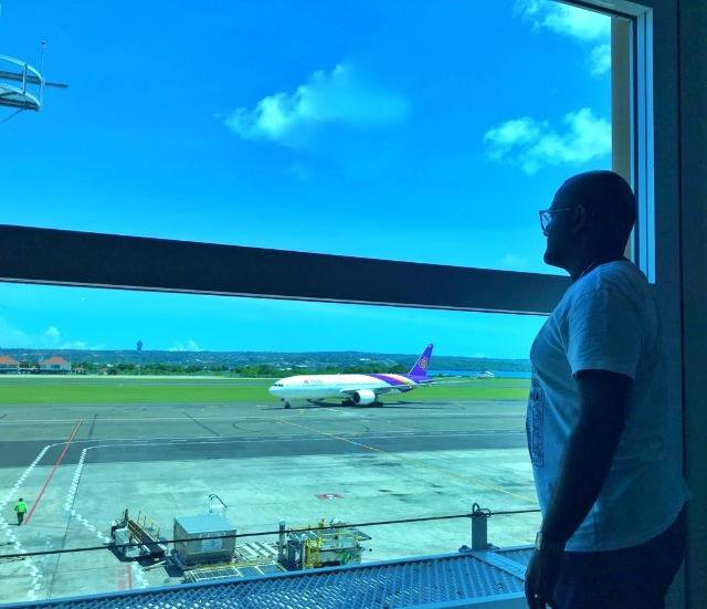 Justin James waiting for his flight from Bali to Hong Kong