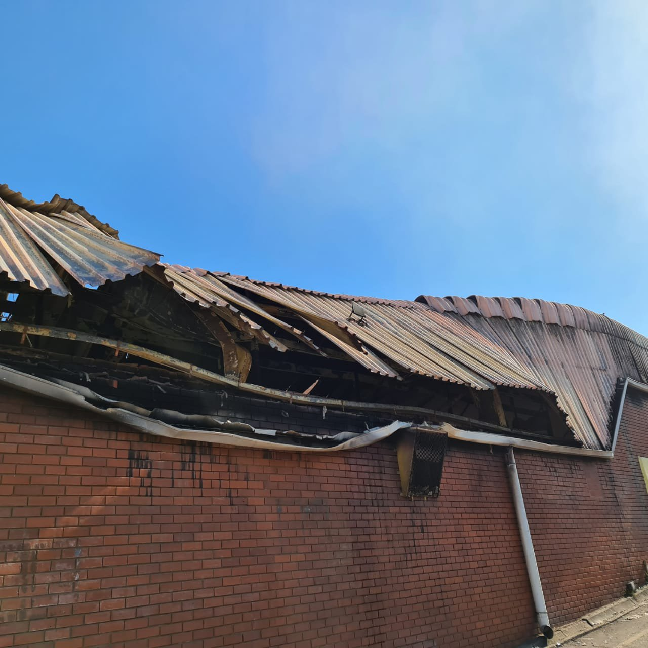 """""""My childhood. My grandparents shop. Looted and on fire as of this morning. I feel numb."""""""