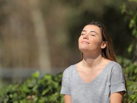 Relaxed girl breathing fresh air in a park