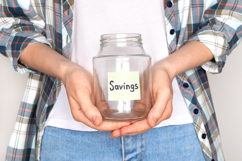 Woman saving money/ iStock