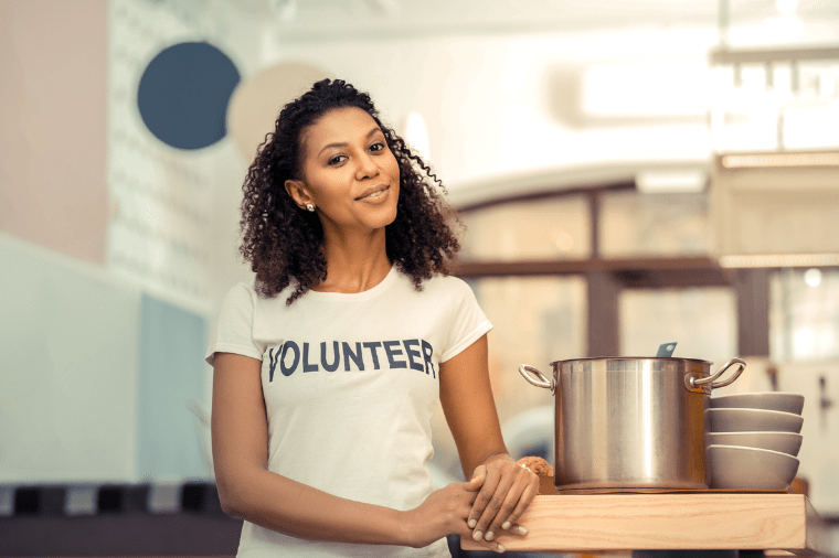 A female volunteer standing in a kitchen
